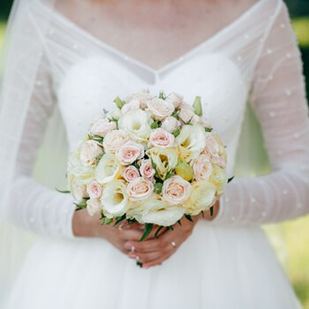 Bride holding bouquet in hands